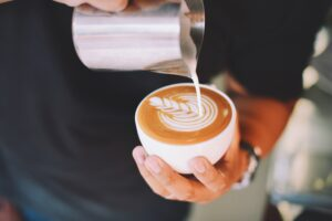 Close-up of Hand Holding Cappuccino Desktop Wallpapers
