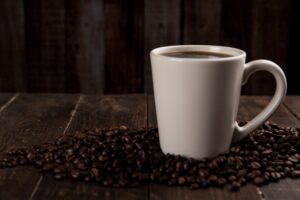 Coffee Mug Surrounded With Coffee Beans Desktop Wallpapers