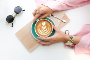 Woman Holding Cup of Latte Desktop Wallpapers