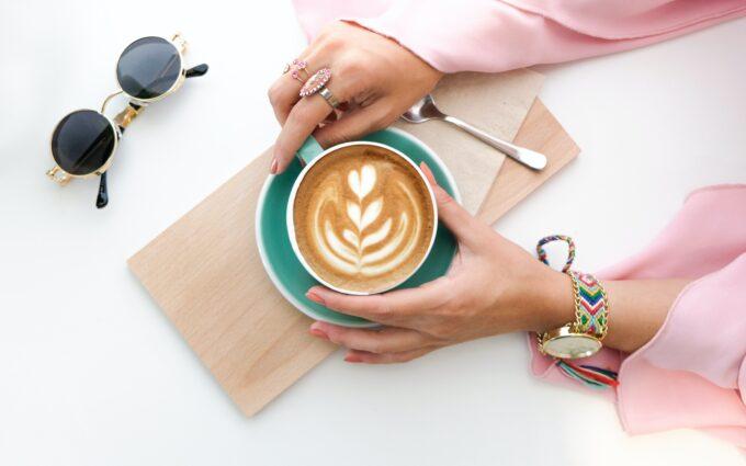 Woman Holding Cup of Latte Desktop Wallpapers